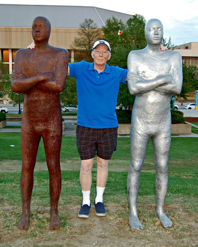 Don Palmer with the statues at Baton Rouge Louisiana. You can tell how tall they are.