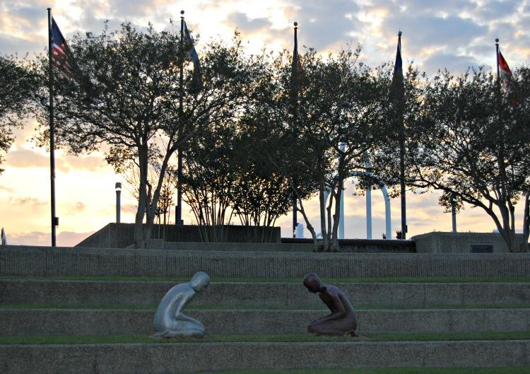 Praying statues along riverfront. Hotel Indigo Baton Rouge Louisiana