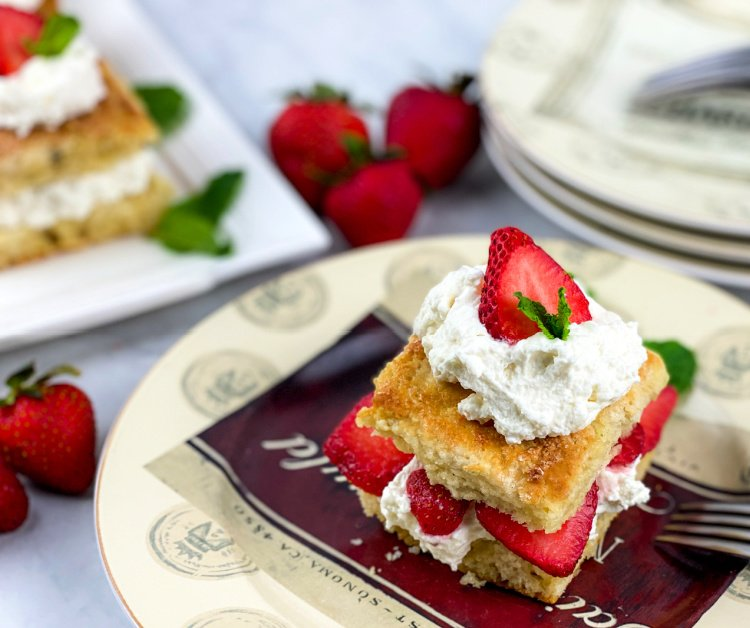 strawberry-shortcake-with-sweet-biscuits-and-whipped-cream-my-home-and-travels- served on a plate with mint