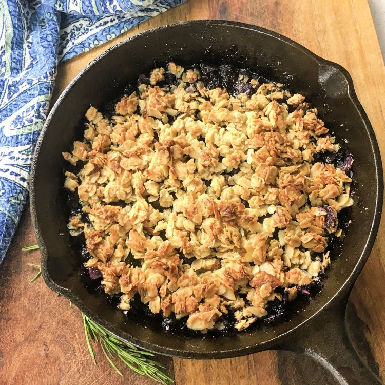 Simple Blueberry Crisp with Maple Syrup my home and travels image blueberry mixture poured into skillet baked