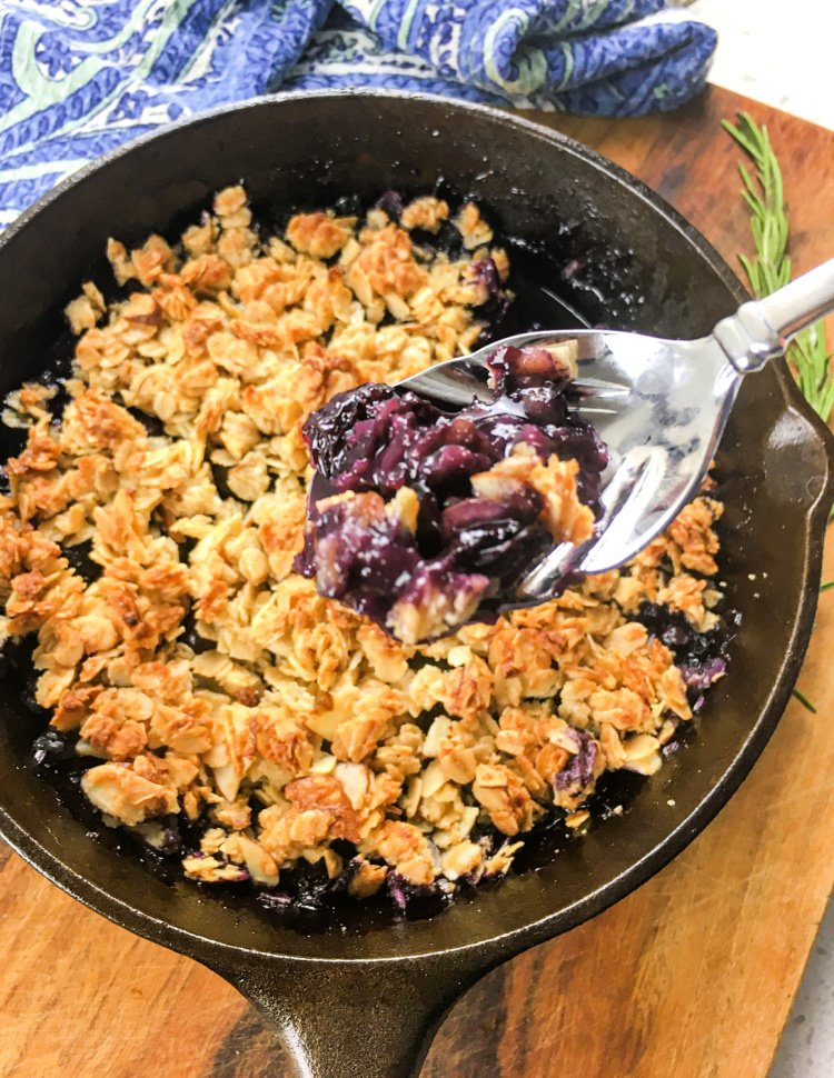 Simple Blueberry Crisp with Maple Syrup my home and travels image blueberry mixture poured into skillet spooned when done