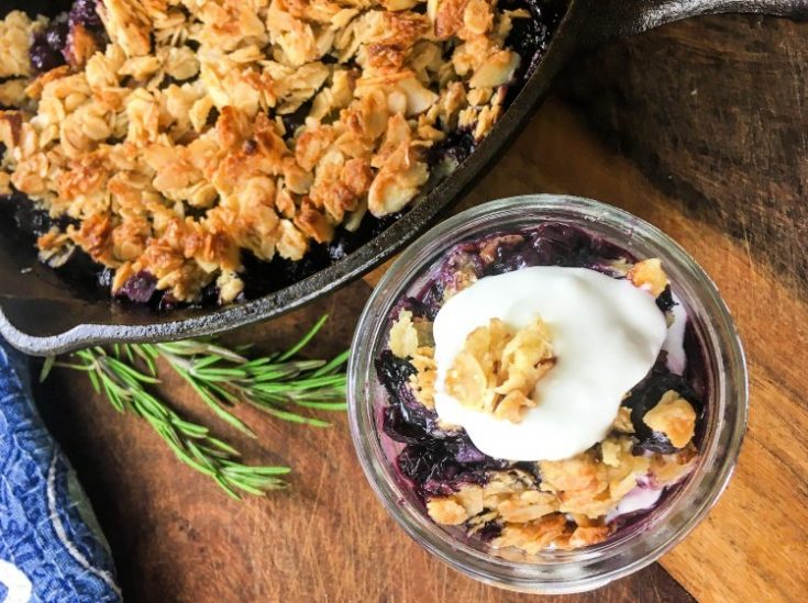 Simple Blueberry Crisp with Maple Syrup my home and travels image blueberry mixture poured into skillet served with topping
